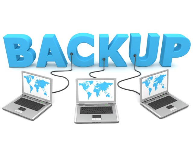 Backing up data and data protection picture of laptops being backed up