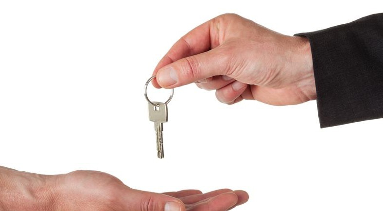 Succession planning picture of handing on a key