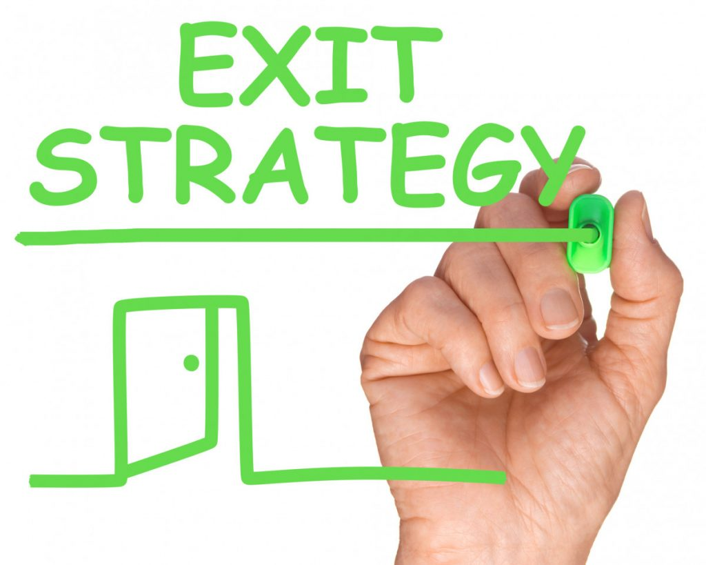 Exit strategies, hand writing exit strategy in green marker