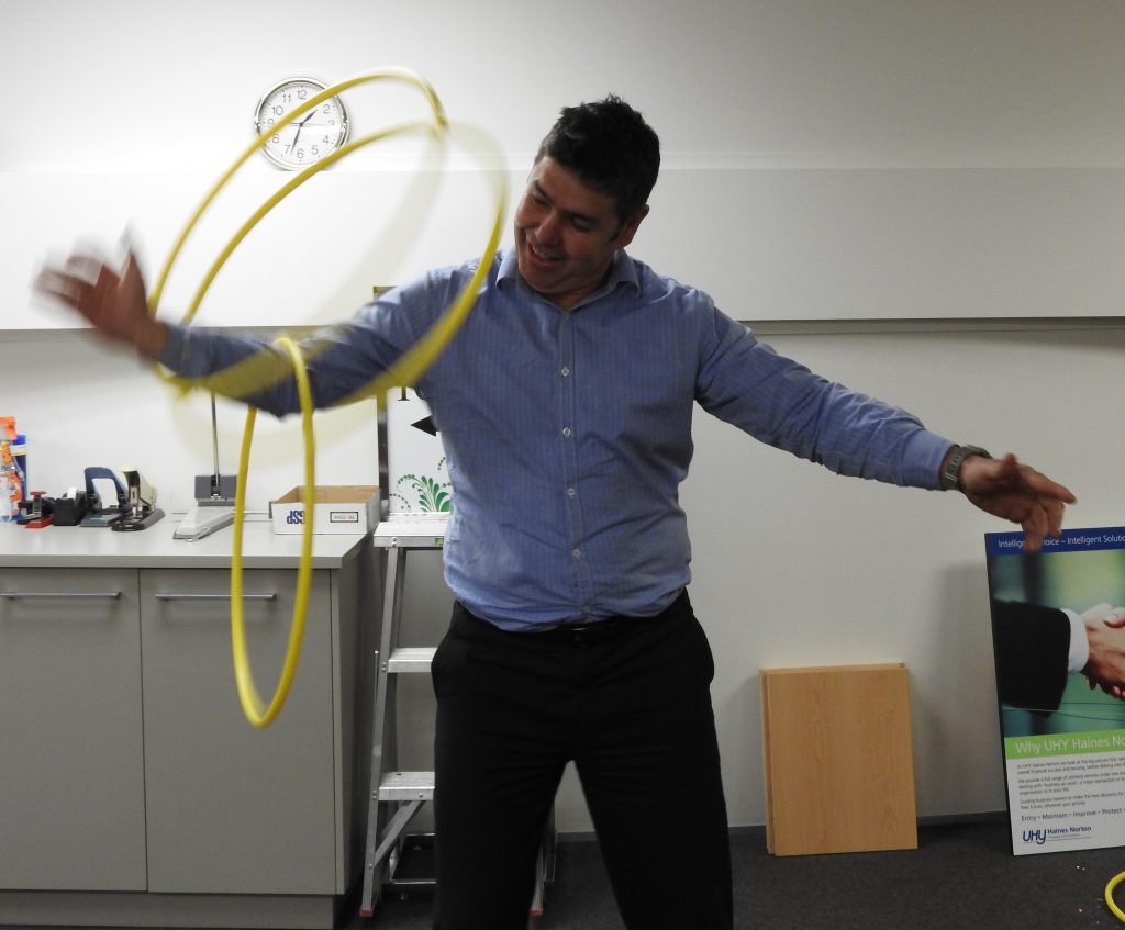 Mark Foster swinging hula hoops having fun at work
