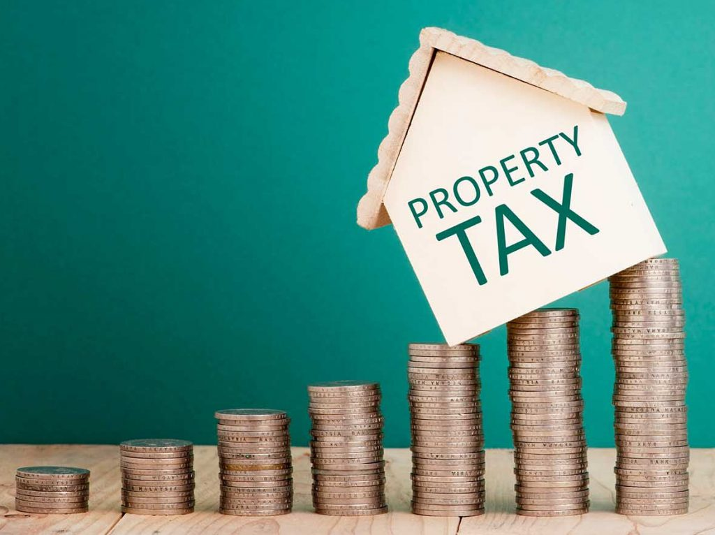 Bright-line test main home exclusion picture of property tax house on coins