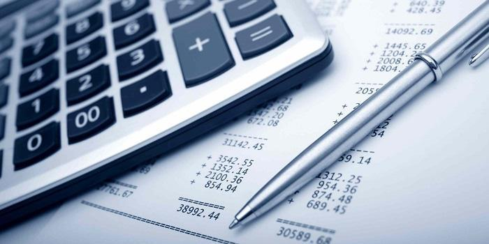 Non-deductible expenses, picture of calculator with sums and pen