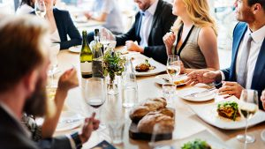 Client entertainment expenses showing business clients eating at a restaurant