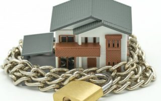 Ring fencing rental losses, picture of house with a chain and padlock around it
