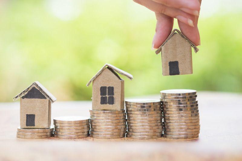 Portfolio basis, toy houses on stacks of coins