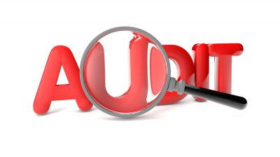 AML CFT Audits, audit with magnifying glass